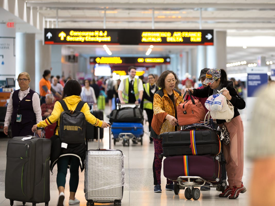 Passengers prepare to check in at Miami International Airport on Feb. 23, 2019.
