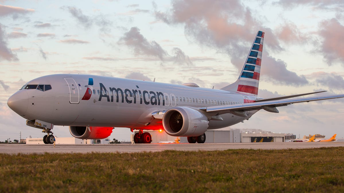 An American Airlines Boeing 737 MAX 8 taxis out for departure from Miami International Airport in February 2019.