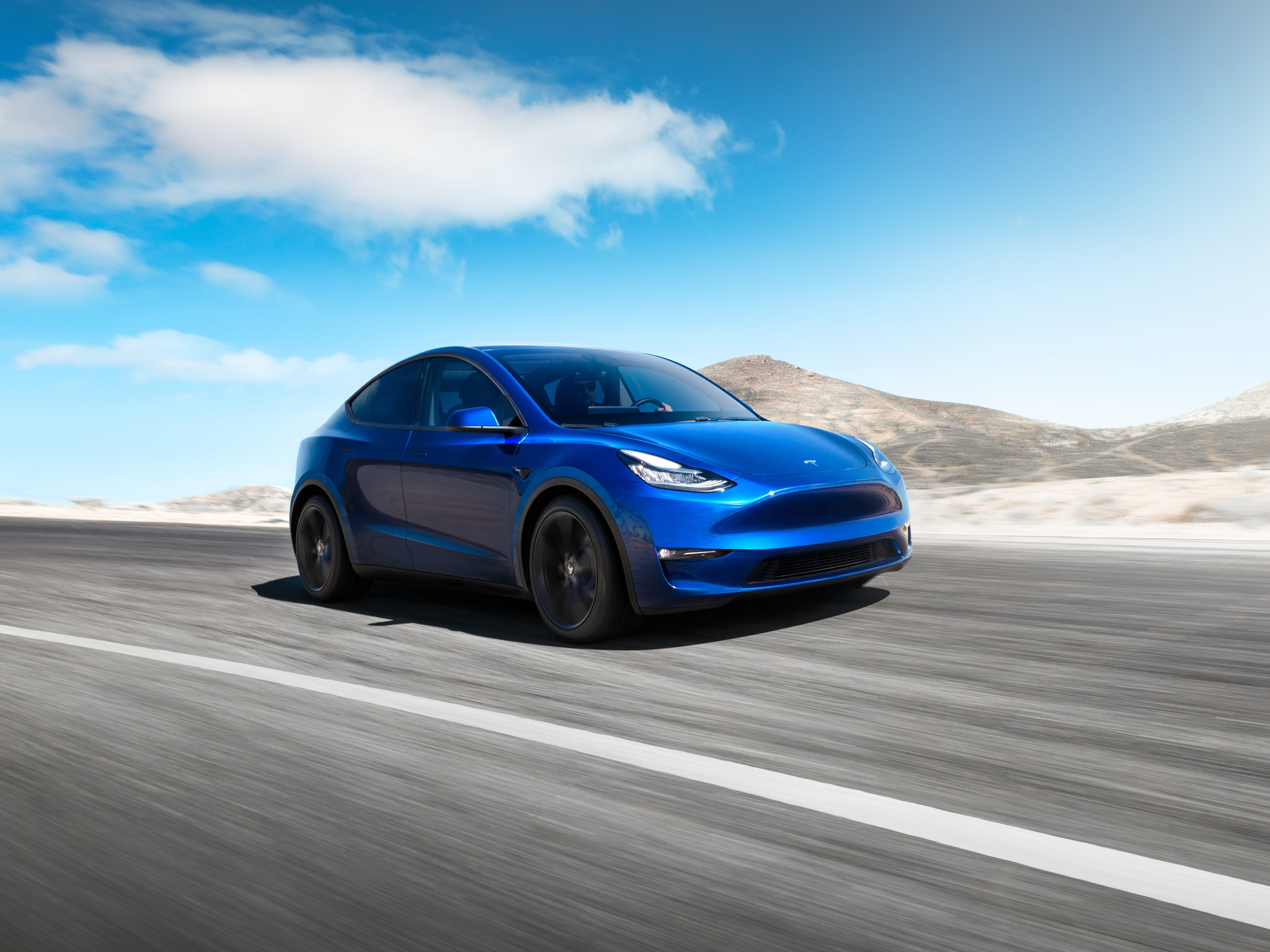 A handout photo made available by US automobile manufacturer Tesla, showing the new Tesla Model Y electric car. Model Y is an all-electric, mid-size SUV, starting at 39,000 USD for the standard version and 47,000 USD for the long-range version has a range of 300 miles.