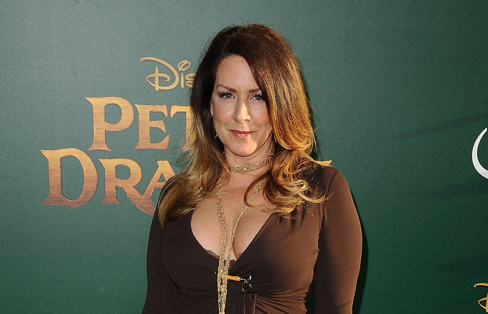 A 'conflicted' Joely Fisher offers former co-star Felicity Huffman prayers amid scandal