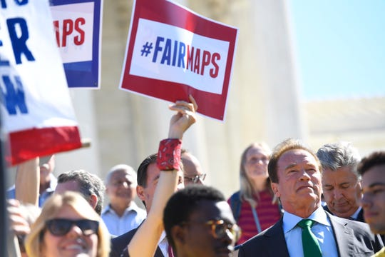 Former Republican Governor of California Arnold Schwarzenegger leads protesters opposed to partisan gerrymandering in 2017.
