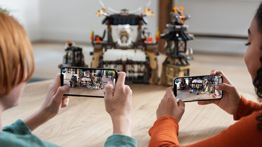 By leveraging the iPhone's camera, augmented reality games superimpose virtual characters, structures and items onto the real world.