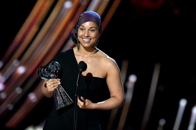 Alicia Keys accepts the iHeartRadio Innovator Award on stage at the 2019 iHeartRadio Music Awards.