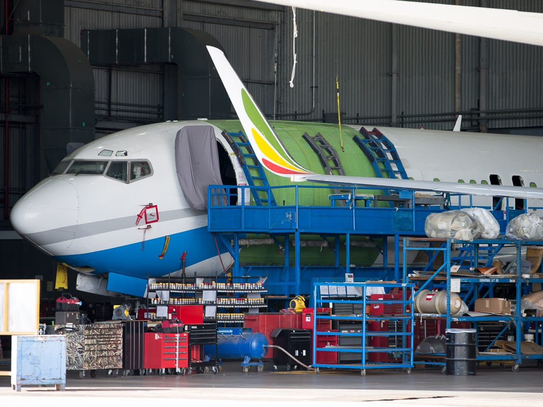 A Boeing 737 is converted from a passenger plane to a freighter with the addition of a cargo door to the forward cabin at Miami International Airport on Feb. 23, 2019.