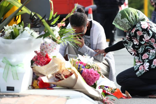 CHRISTCHURCH, NEW ZEALAND - MARCH 16: Locals lay flowers in tribute to those killed and injured at Deans Avenue near the Al Noor Mosque on March 16, 2019 in Christchurch, New Zealand. At least 49 people are confirmed dead, with more than 40 people injured following attacks on two mosques in Christchurch on Friday afternoon. Of the victims, 41 were killed at Al Noor Mosque on Deans Avenue and seven died at the Linwood Mosque. Another victim died later in Christchurch hospital. Three people are in custody over the mass shootings. One man has been charged with murder.  (Photo by Fiona Goodall/Getty Images) ORG XMIT: 775315734 ORIG FILE ID: 1136041681
