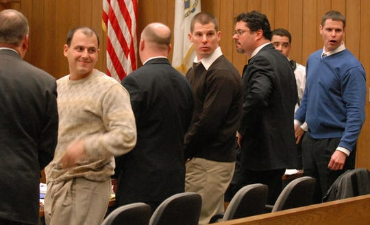 "At the end of the first day of trial for extortion conspiracy in Hampden Superior Court in Springfield, Mass., Wednesday, Jan. 23, 2008, Anthony J. Arillotta, 39, second from left, smiles to family members in the court.  From left at the defense table are Vincent A. Bongiorni, Arillotta's attorney, Arrilotta, attorney Daniel D. Kelly with his client Ty C. Geas, 35, center, and attorney Peter Murphy with client Fotios A. ""Freddy""  Geas, 40. (AP Photo/The Republican, Michael S. Gordon)"