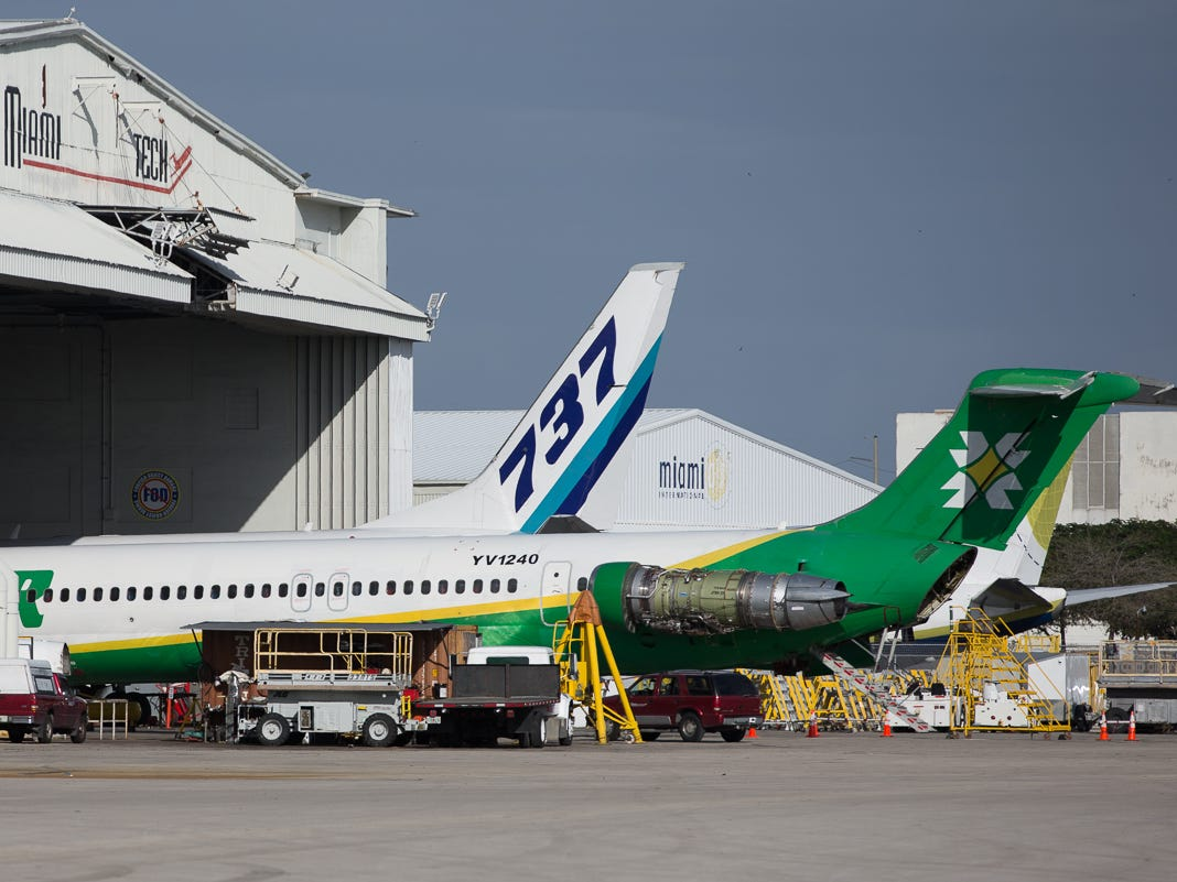Odd bedfellows Laser Airlines (MD-80) and Eastern (737) are worked on at a maintenance hanger at Miami International Airport in February 2019.