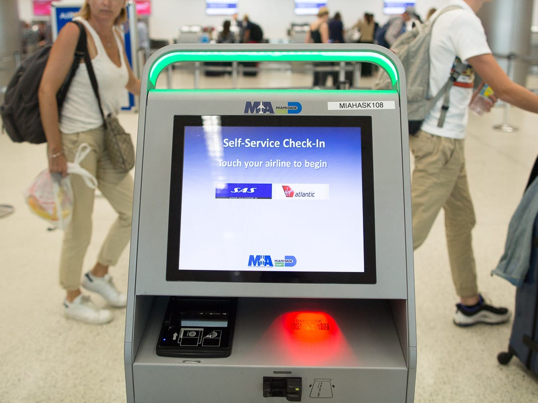 A check-in kiosk awaits passengers in Miami International Airport on Feb. 23, 2019.