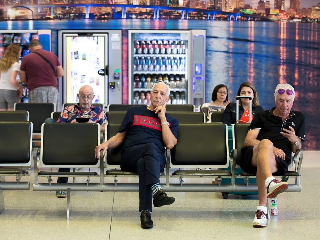 Passengers await their flights at Miami International Airport's Terminal J on Feb. 23, 2019.