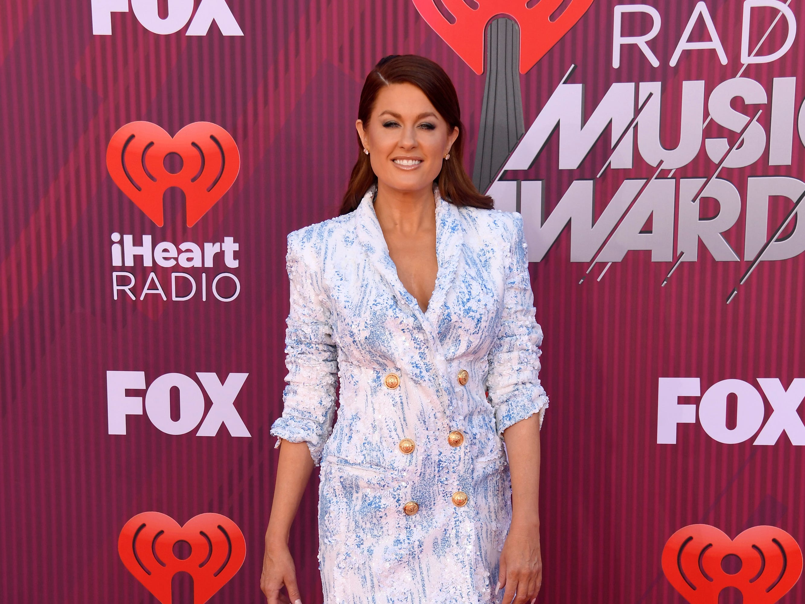 Hilary Roberts arrives at the iHeartRadio Music Awards.
