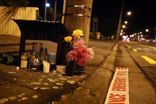 Floral tributes are left before dawn at Deans Avenue near the Al Noor Mosque on March 16, 2019, in Christchurch, New Zealand.