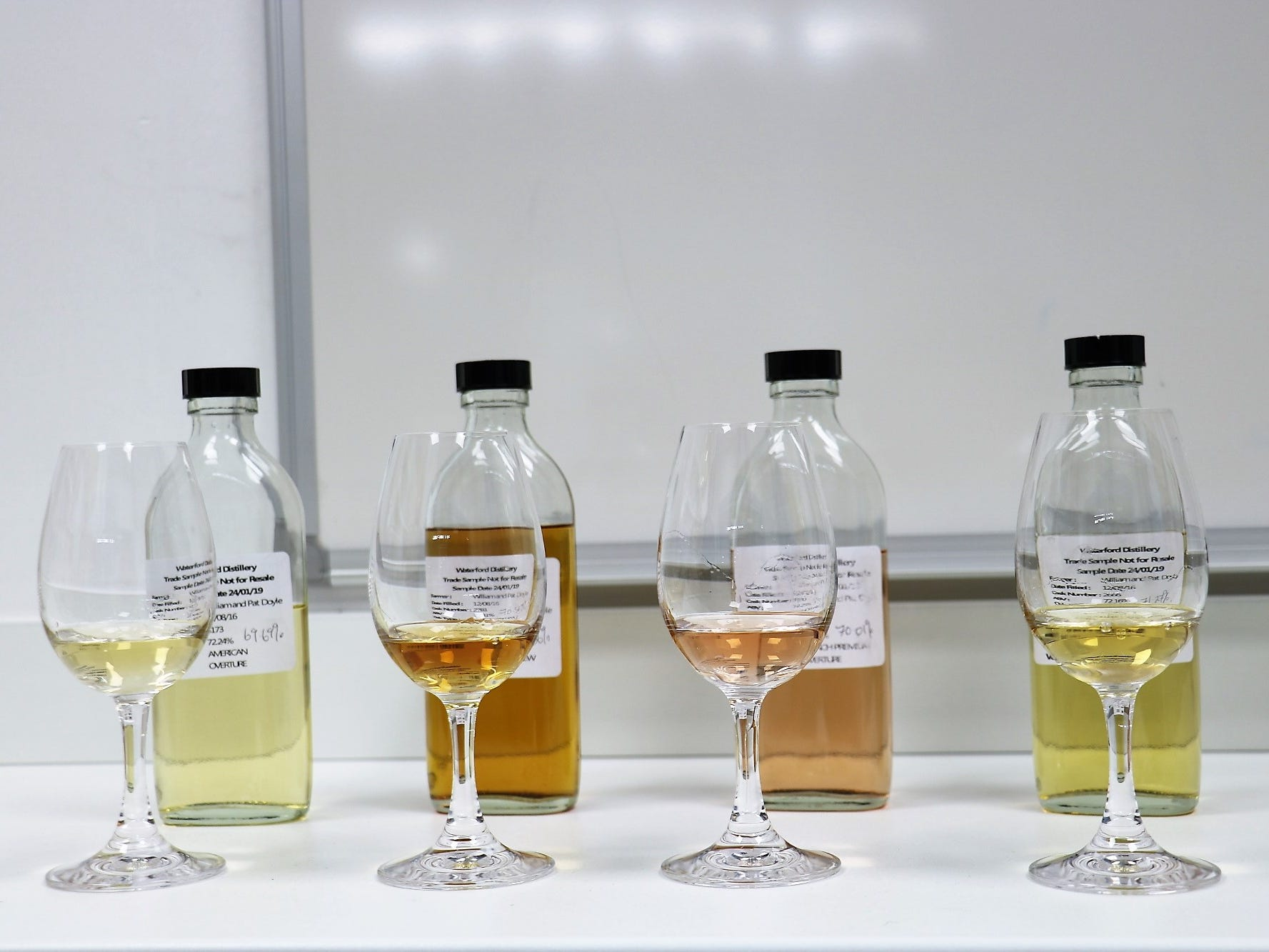 An assortment of samples showcases a range of colors stemming from different barrel types. Premium French casks which held red wine offer the unique rose color of the whiskey seen second from right. The distillery has experimented with different types of wood, including chestnut, wild cherry, acacia and mulberry.
