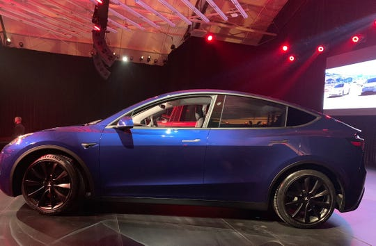 The Tesla Mannequin Y SUV is printed at an match in the Los Angeles space.