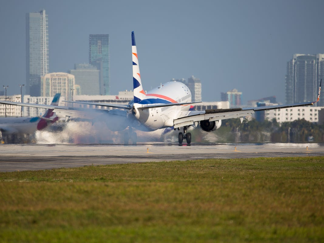 A plane belonging to Canadian-based Flair Air lands at Miami International Airport on Feb. 23, 2019.