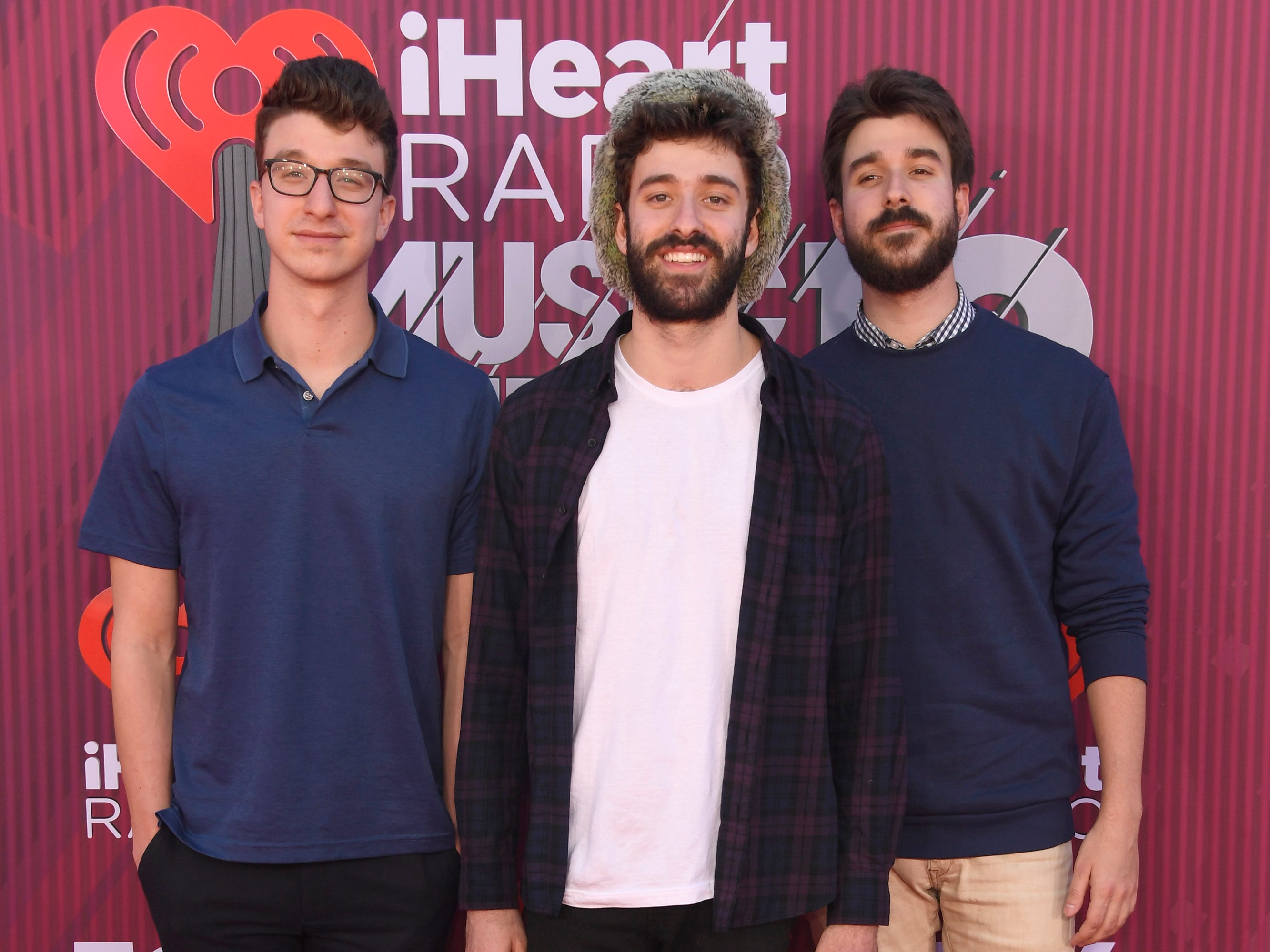 Ryan Joshua Met, Jack Evan Met, and Adam Brett Met of AJR arrive at the iHeartRadio Music Awards.