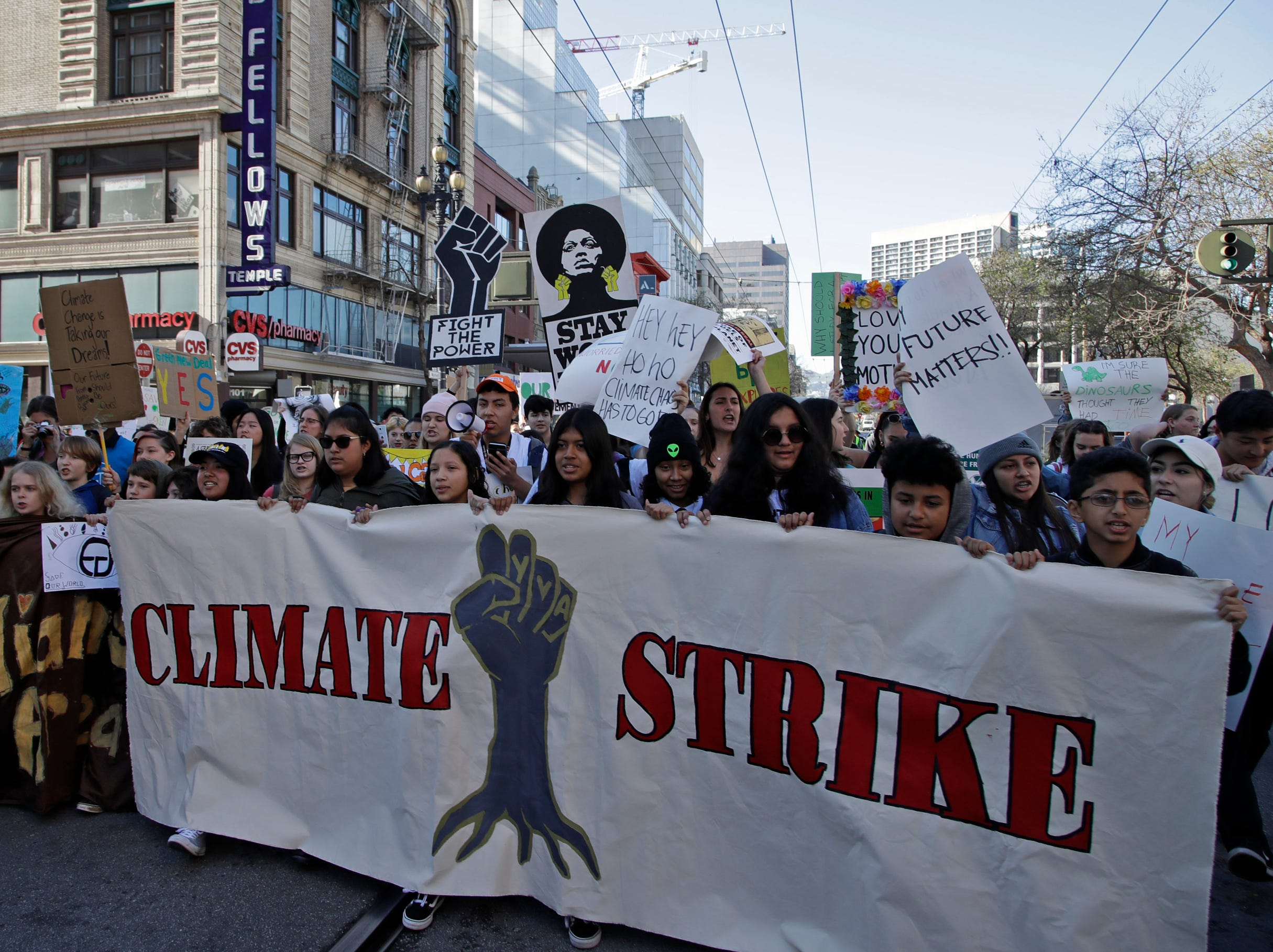 Students march along Market Street during a protest against climate change Friday, March 15, 2019, in San Francisco. From the South Pacific to the edge of the Arctic Circle, students are skipping classes to protest what they see as the failures of their governments to take tough action against global warming. The 'school strikes' on Friday were inspired by 16-year-old Swedish activist Greta Thunberg and are taking place in over 100 countries.