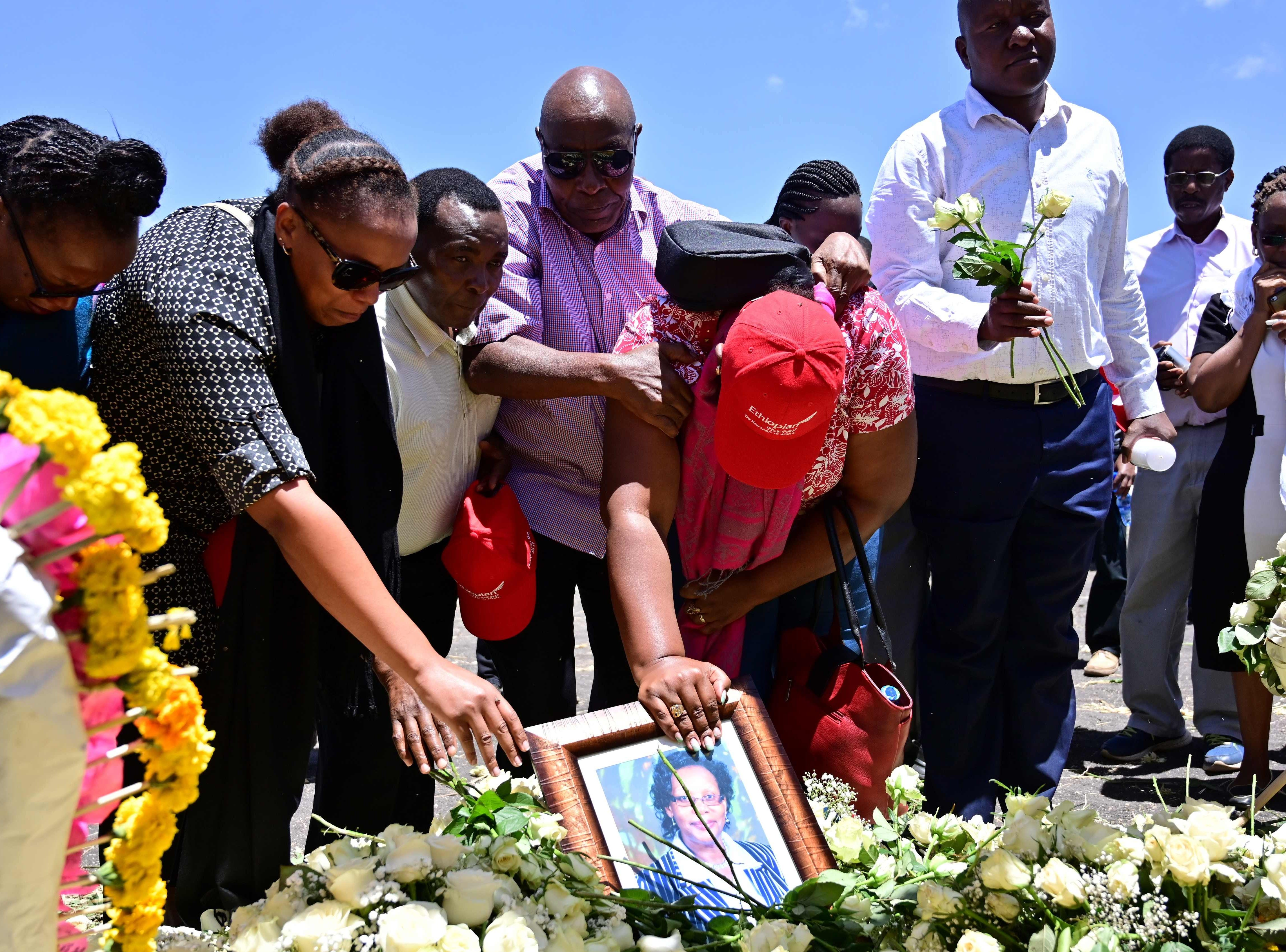 Families of victims from Kenya and Rwanda lay flowers as they visit the crash site.
