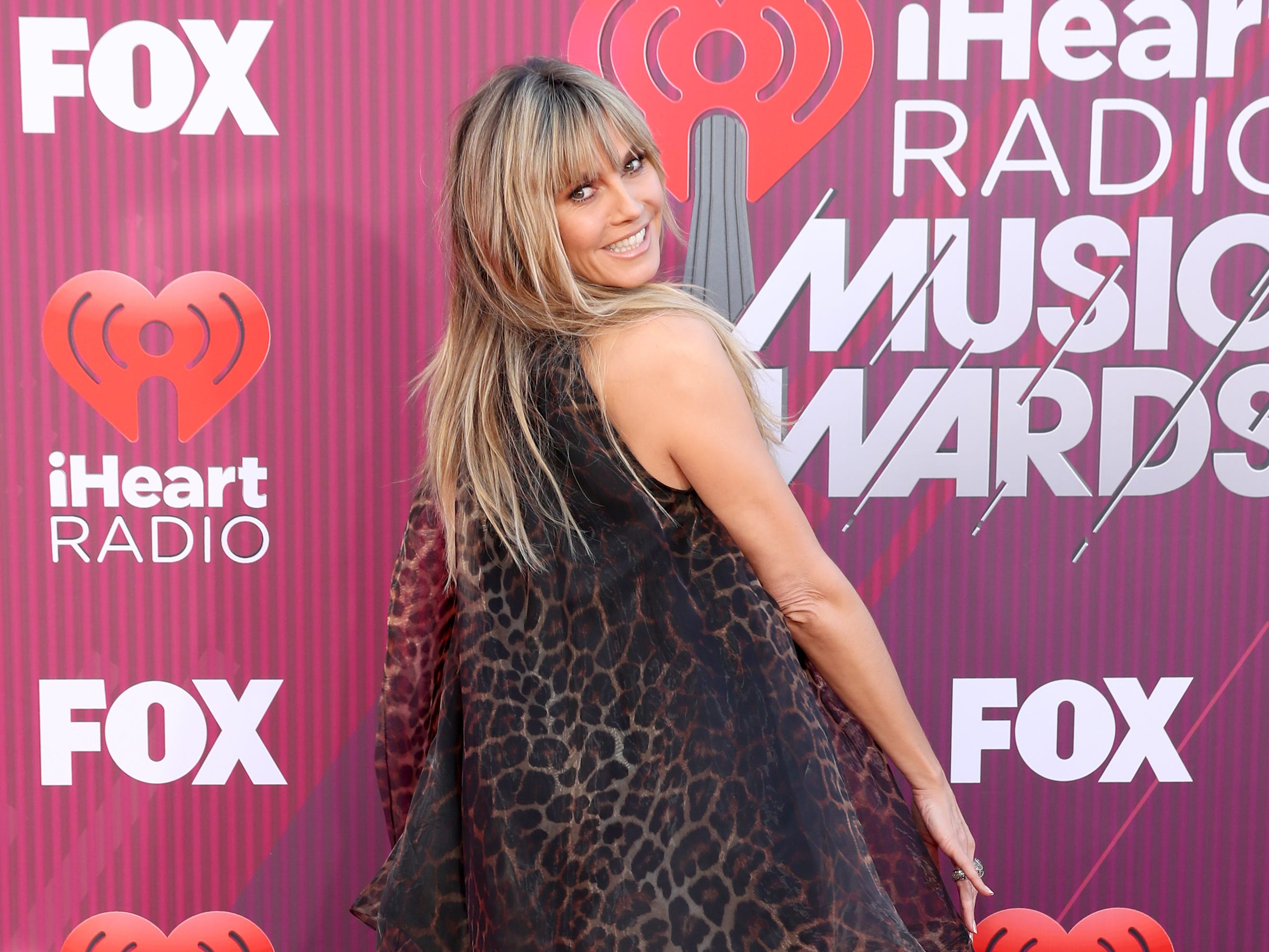 Heidi Klum arrives at the iHeartRadio Music Awards.