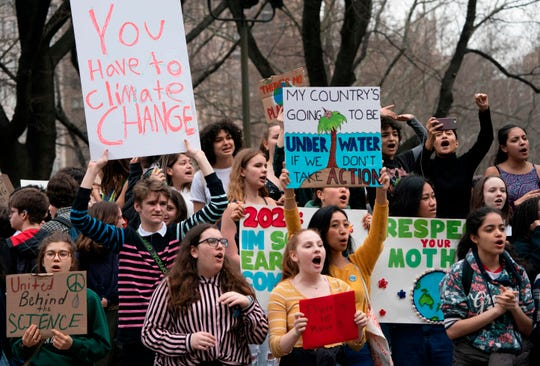 Protesters gather during the Global Climate Strike NYC March March 15, 2019 near Columbus Circle in New York. - Hundreds of thousands of young people skipped school across the globe on Friday, March 15, 2019 to march through the streets for an international day of student protests aimed at pushing world leaders into action on climate change.