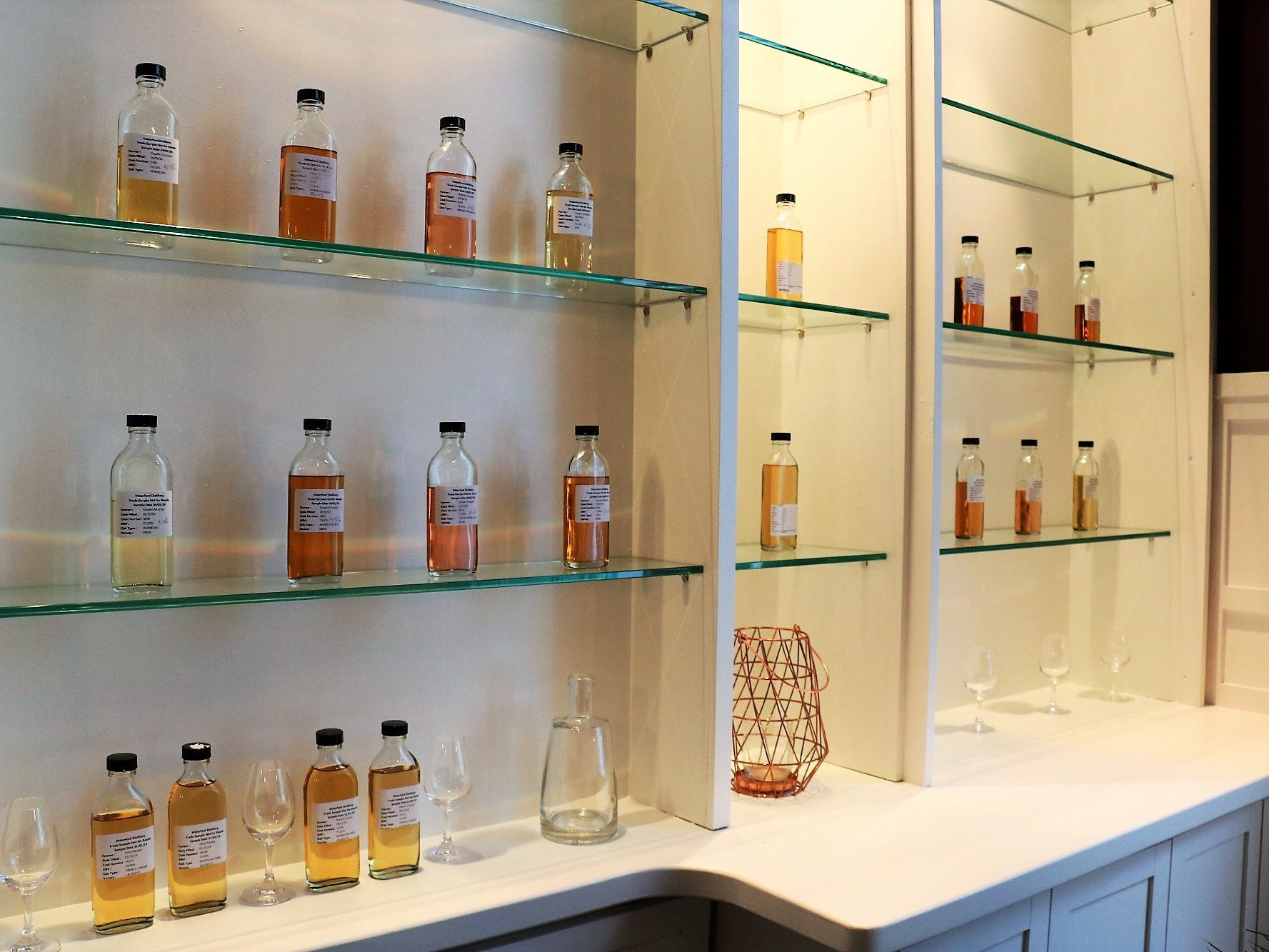"A display of whiskey samples showcases a broad spectrum of colors stemming from a range of cask types. ""They are all components, just as all the barley and farms are components,"" Newton says."