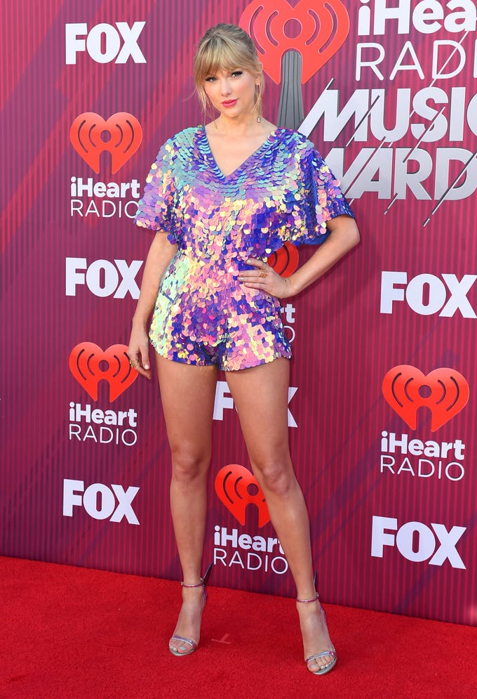 Taylor Swift arrives at the iHeartRadio Music Awards.