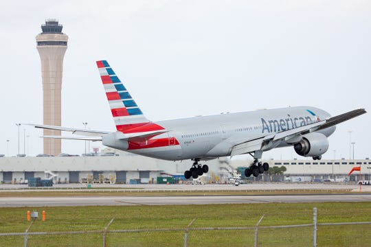 An American Airlines Boeing 777 lands at Miami International Airport on Feb. 24, 2019.