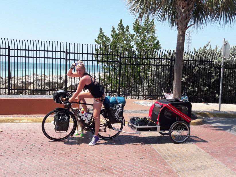 Florida cyclist Stefanie Boewe biked the entire East Coast Greenway from Key West, Florida, to Calais, Maine, pulling a trailer and accompanied by her 6-year-old Australian shepherd, Murf.