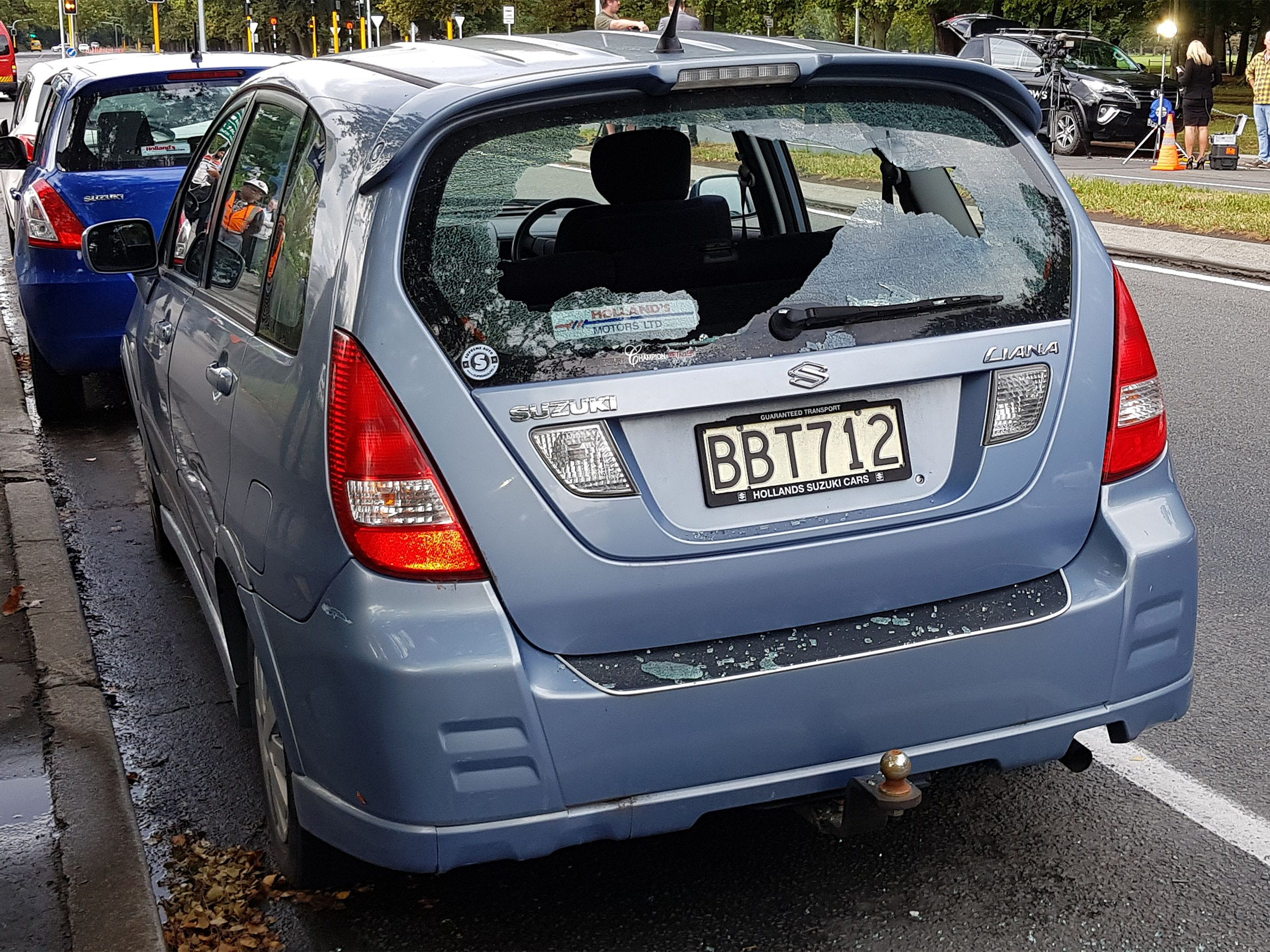A car with shattered windows is parked close to the Masjid al Noor mosque  in Christchurch on March 15, 2019 after a gunman opened fire inside the mosque during afternoon prayers.
