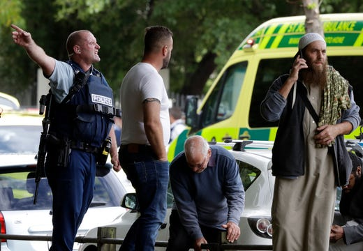Police attempt to clear people from outside a mosque in central Christchurch, New Zealand.