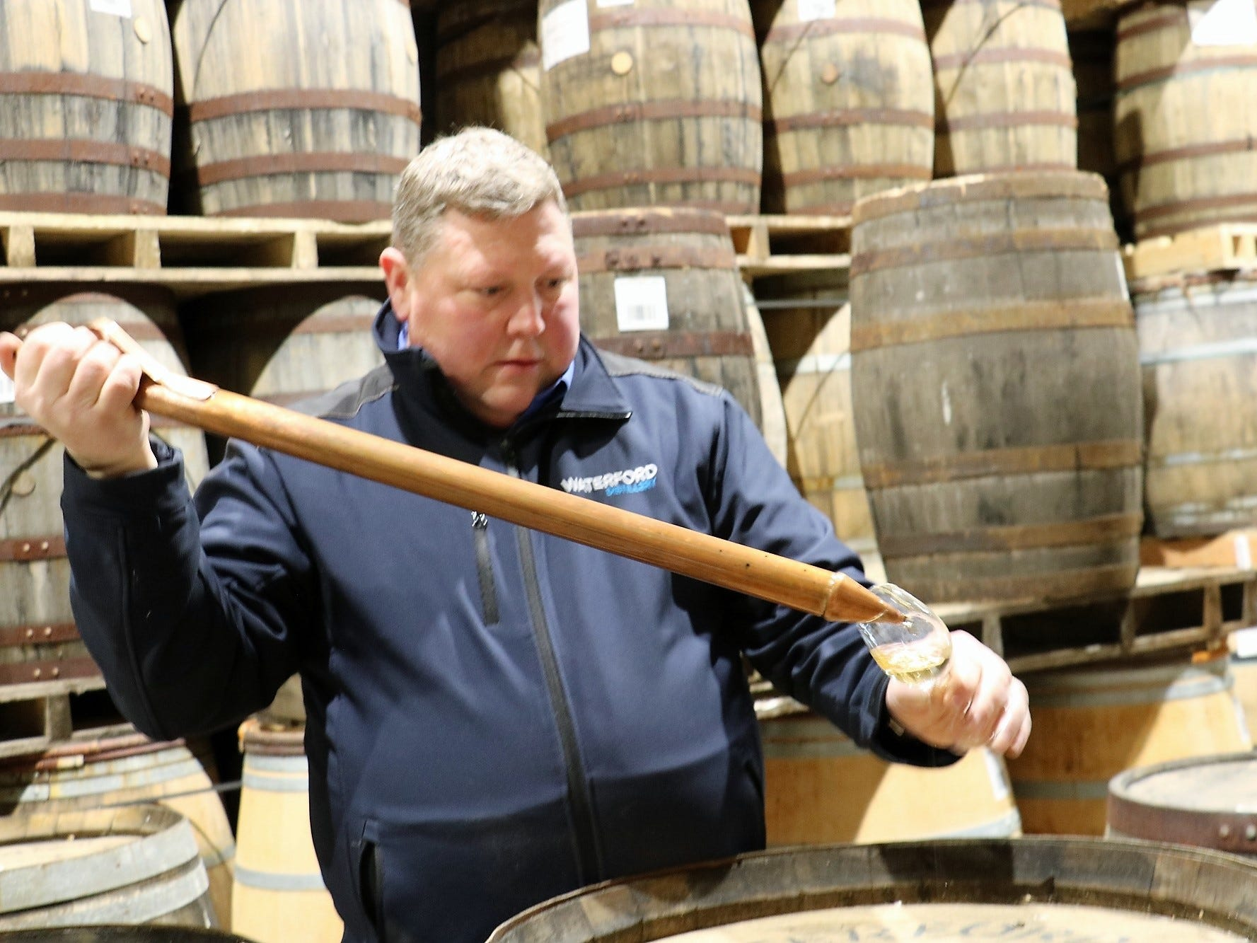 Gahan pulls a cask sample for a taste. Waterford uniquely barrels its whiskey at its full distillation strength, approximately 71 percent ABV, as opposed to diluting it prior to maturation.