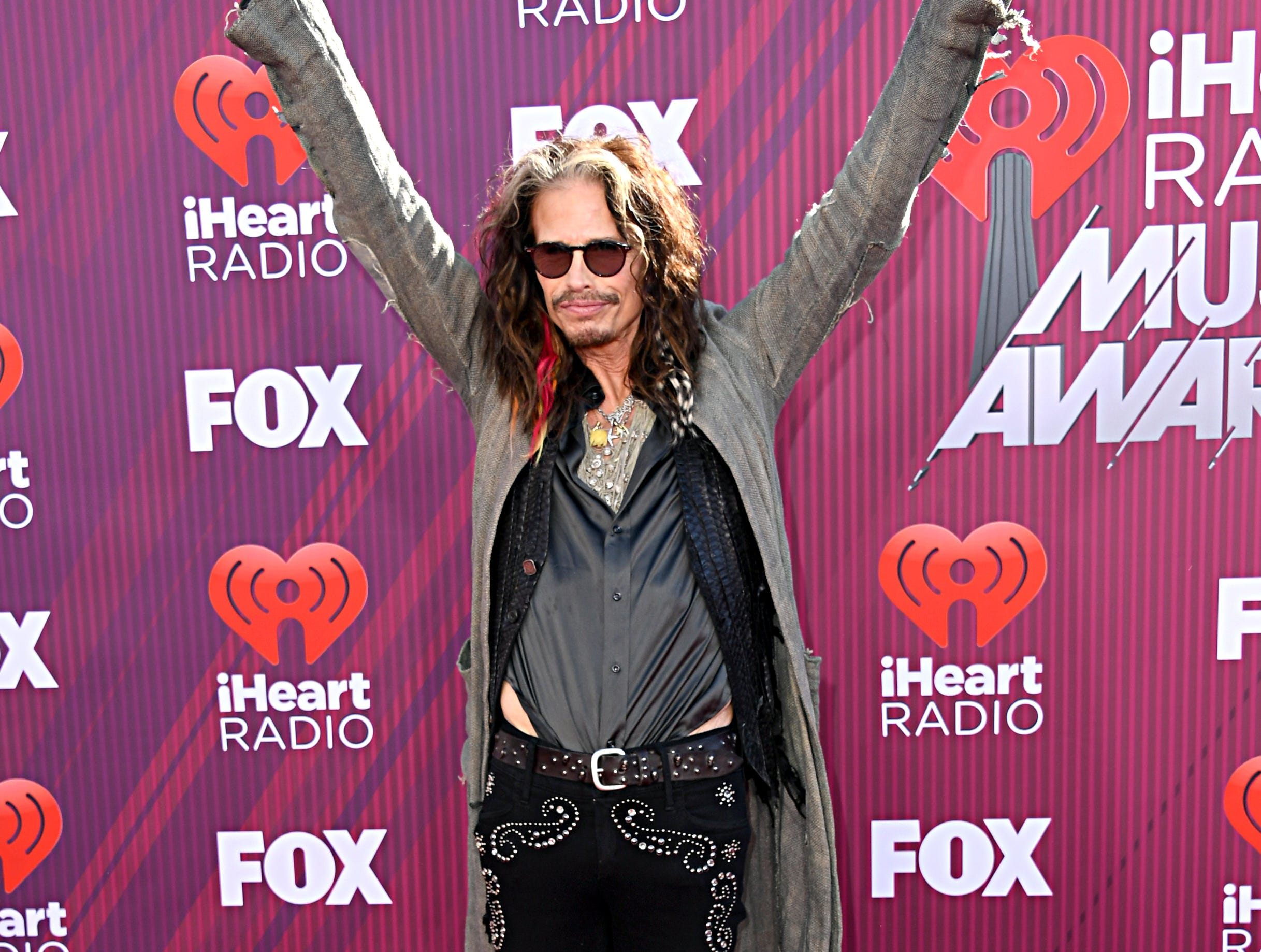 Steven Tyler arrives at the iHeartRadio Music Awards.