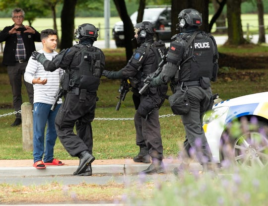 Armed police push back members of the public following a shooting resulting in multiple fatalities and injuries at the Masjid Al Noor on Deans Avenue in Christchurch, New Zealand, 15 March 2019. According to media reports on 15 March 2019, a gunman opened fire at around 1:40 pm local time after walking into the mosque, killing multiple people.