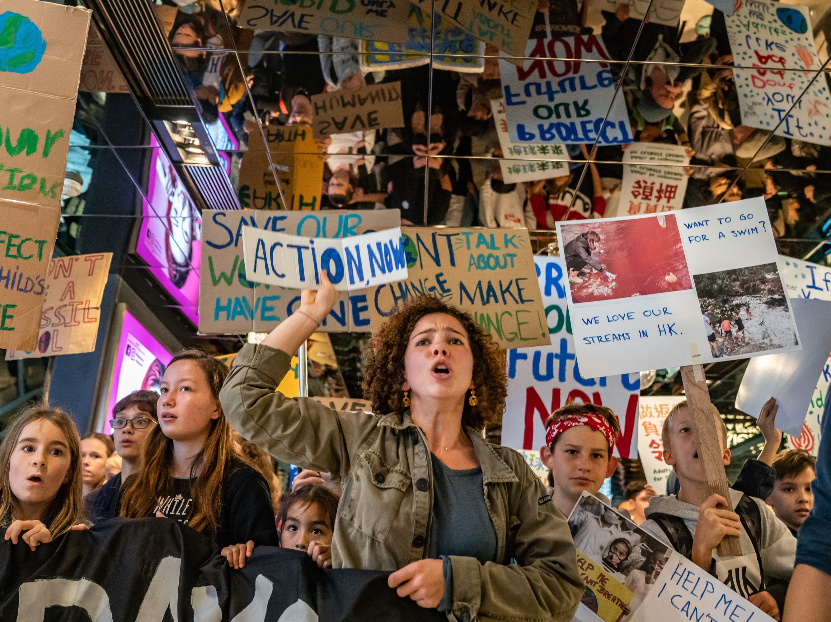 Students hold placards and shout slogans as they participate in a protest on March 15, 2019 in Hong Kong, China.
