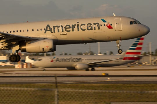 "An American Airlines Airbus A321 lands at Miami International Airport on February 24, 2019. ""Width ="" 540 ""data-mycapture-src ="" ""data-mycapture-sm-src ="""