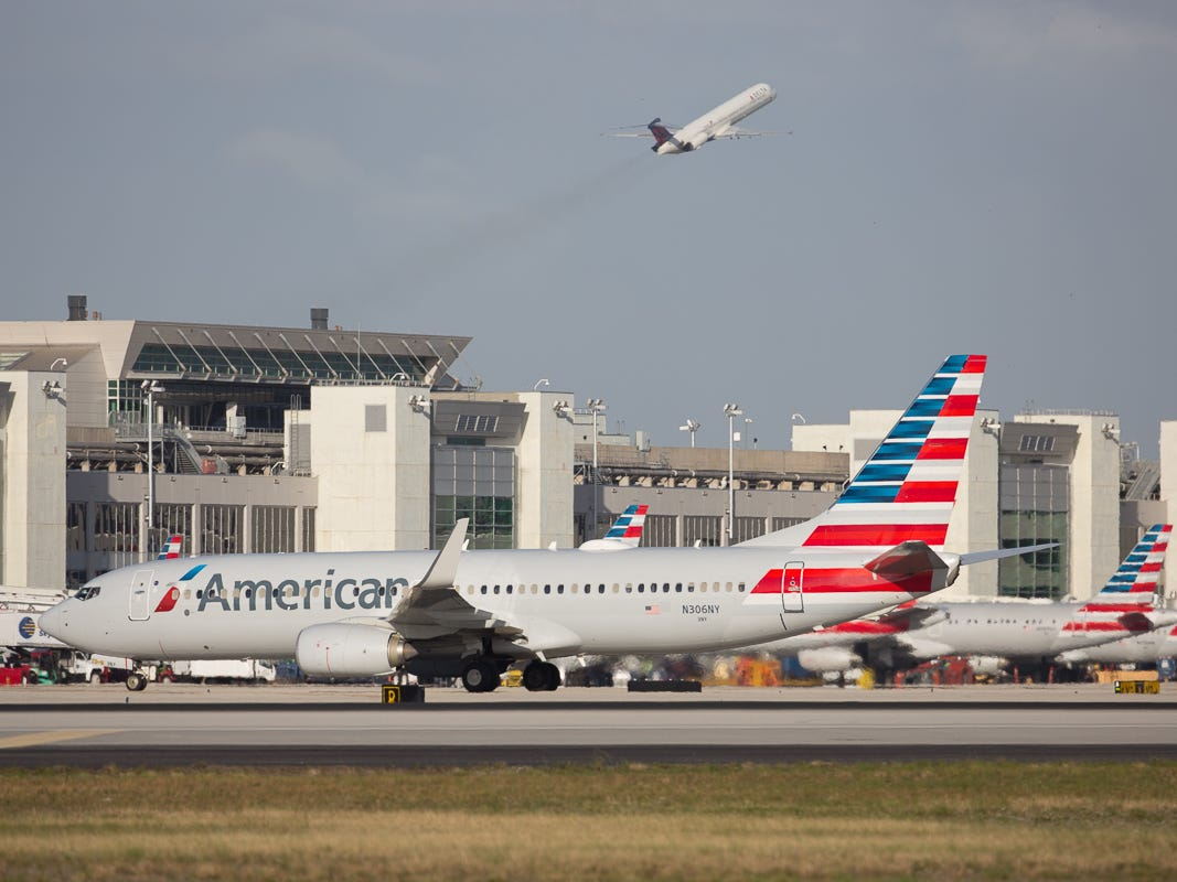 American Airlines jets fill the D concourse at Miami International Airport on Feb. 23, 2019.