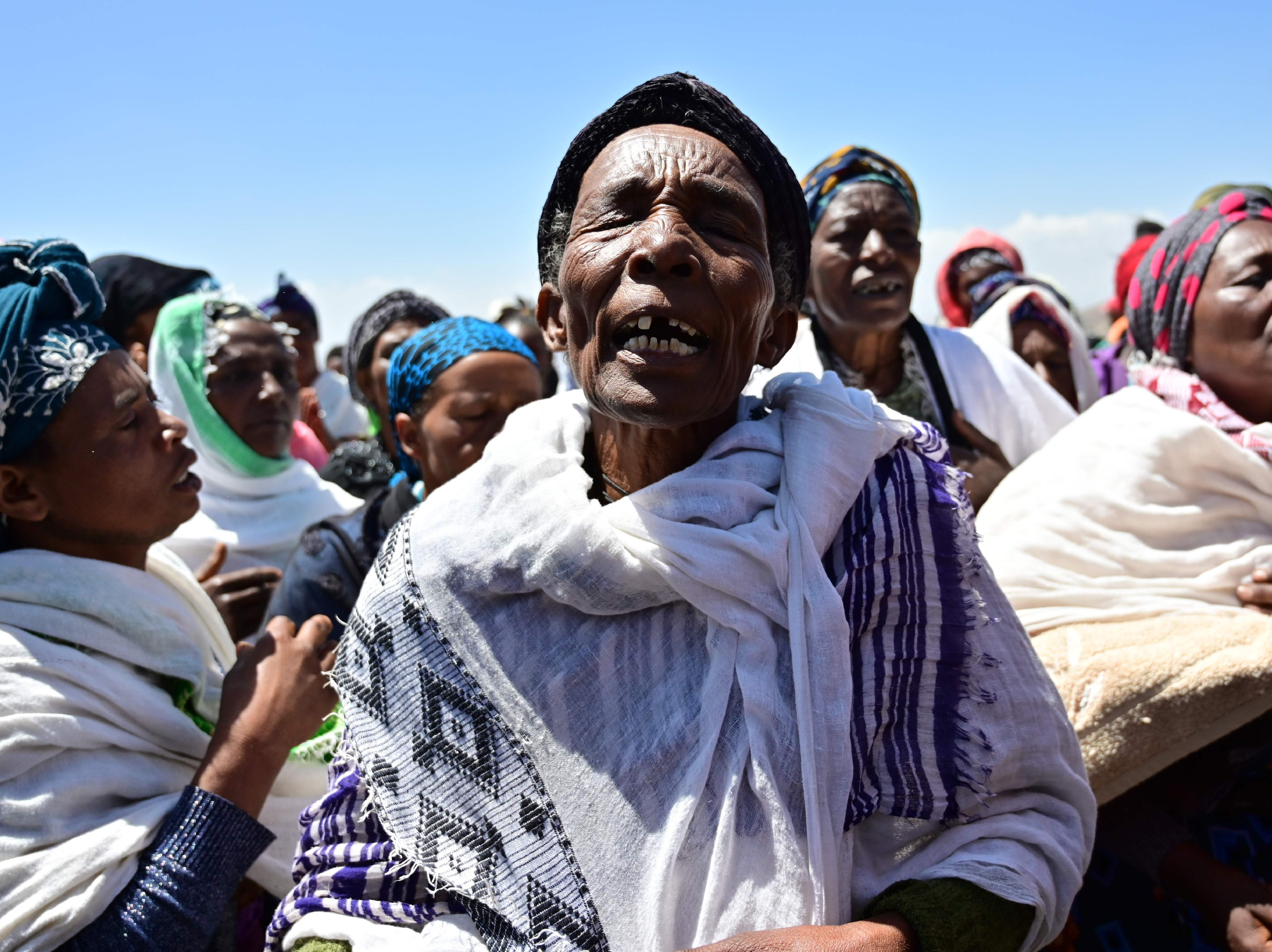 Oromo women perform a traditional chant  at the  crash site of the Ethiopian Airlines Boeing 737 MAX aircraft.