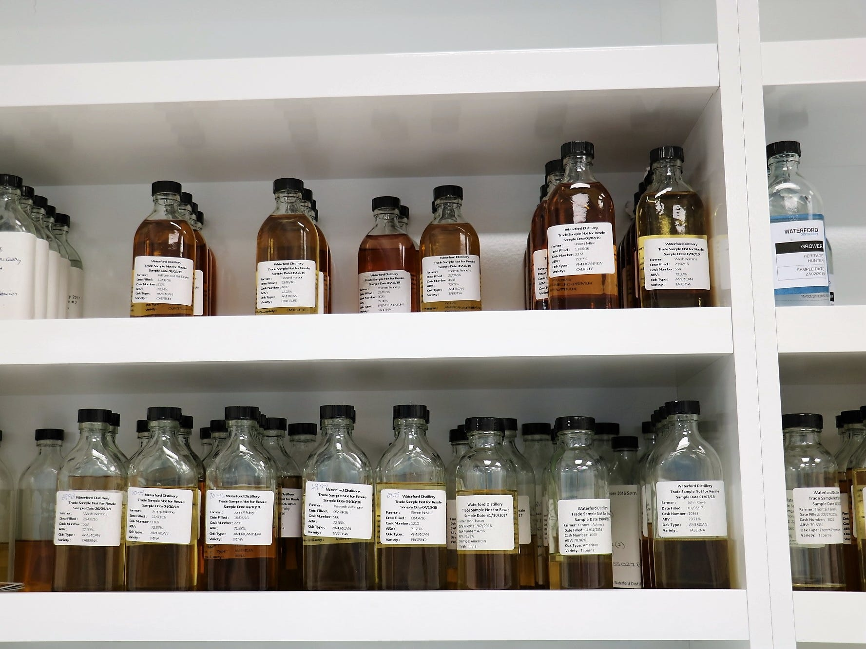 """Samples are labeled with the farmer name, date the spirit went into barrel, which cask the sample was pulled from and what type of oak it was, ABV of the spirit, and barley variety. Some may be destined for single-farm releases, while all will eventually become part of the distillery's core """"cuvée,"""" blending together its many flavors."""
