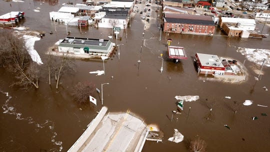 The swollen Pecatonica River spills into downtown Darlington on Thursday.