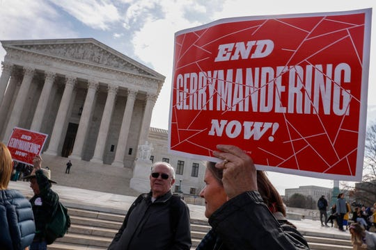Protesters demonstrate outside the Supreme Court last March when the justices last considered partisan gerrymandering.