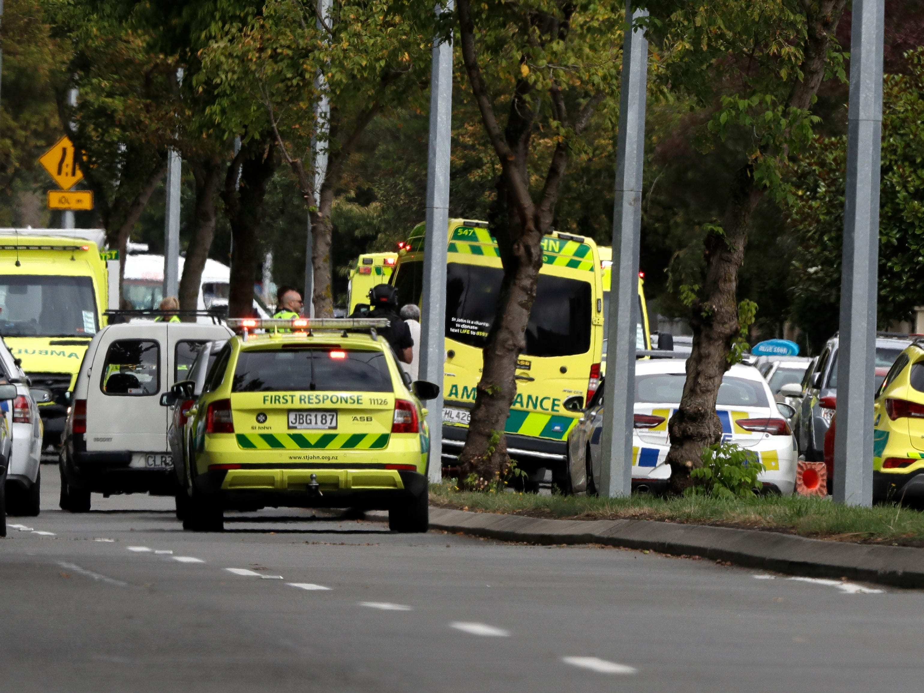 Ambulances are pictured parking outside a mosque in central Christchurch, New Zealand.