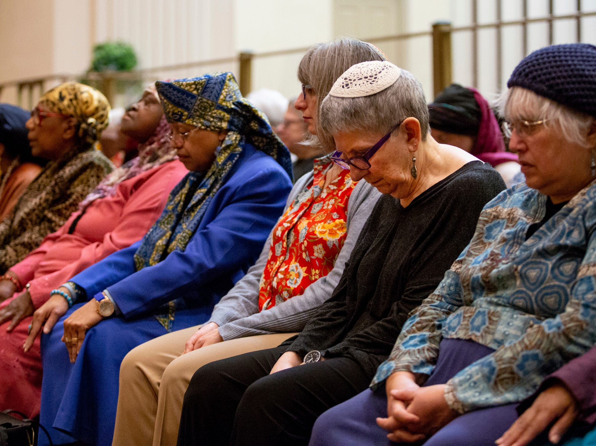 Rabbi Linda Holtzman, second from right, attends an interfaith service held in honor and solidarity with the people killed in the deadly attacks on mosques in New Zealand at an Masjidullah Mosque in Philadelphia, Friday, March 15, 2019.
