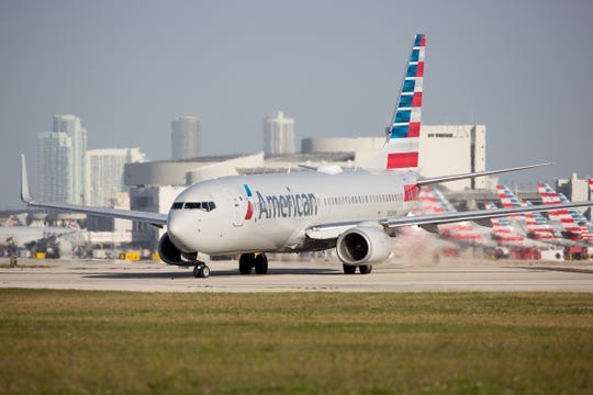 In this February 2019 file photo, an American Airlines Boeing 737-800 taxis to runway 8R at Miami International Airport.