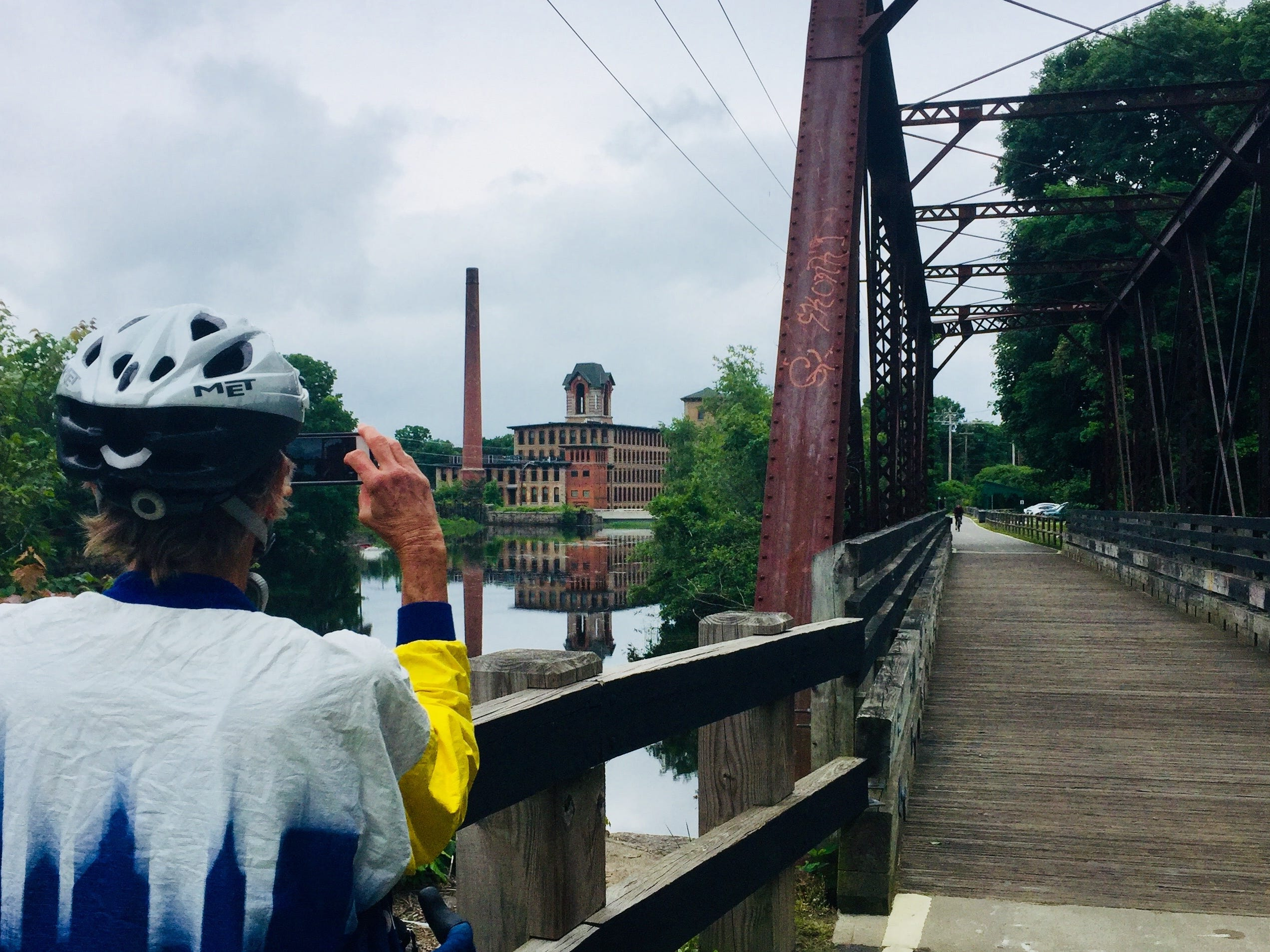 Cross half the width of Rhode Island on the Washington Secondary Bike Path, with views of ponds and brick mills.