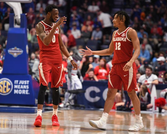 Alabama Crimson Tide forward Donta Hall (0) and Alabama Crimson Tide guard Dazon Ingram (12) celebrate after a win against the Mississippi Rebels in the SEC conference tournament at Bridgestone Arena.