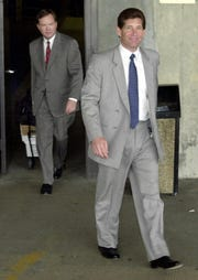 Mobsters-turned-informant Michael DiLeonardo, right, leaves the federal building in Atlanta in  2001.