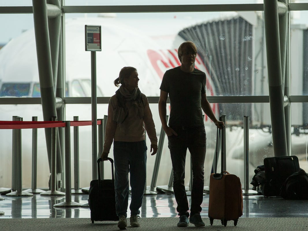 Passengers walk through Terminal J at Miami International Airport on Feb. 23, 2019.