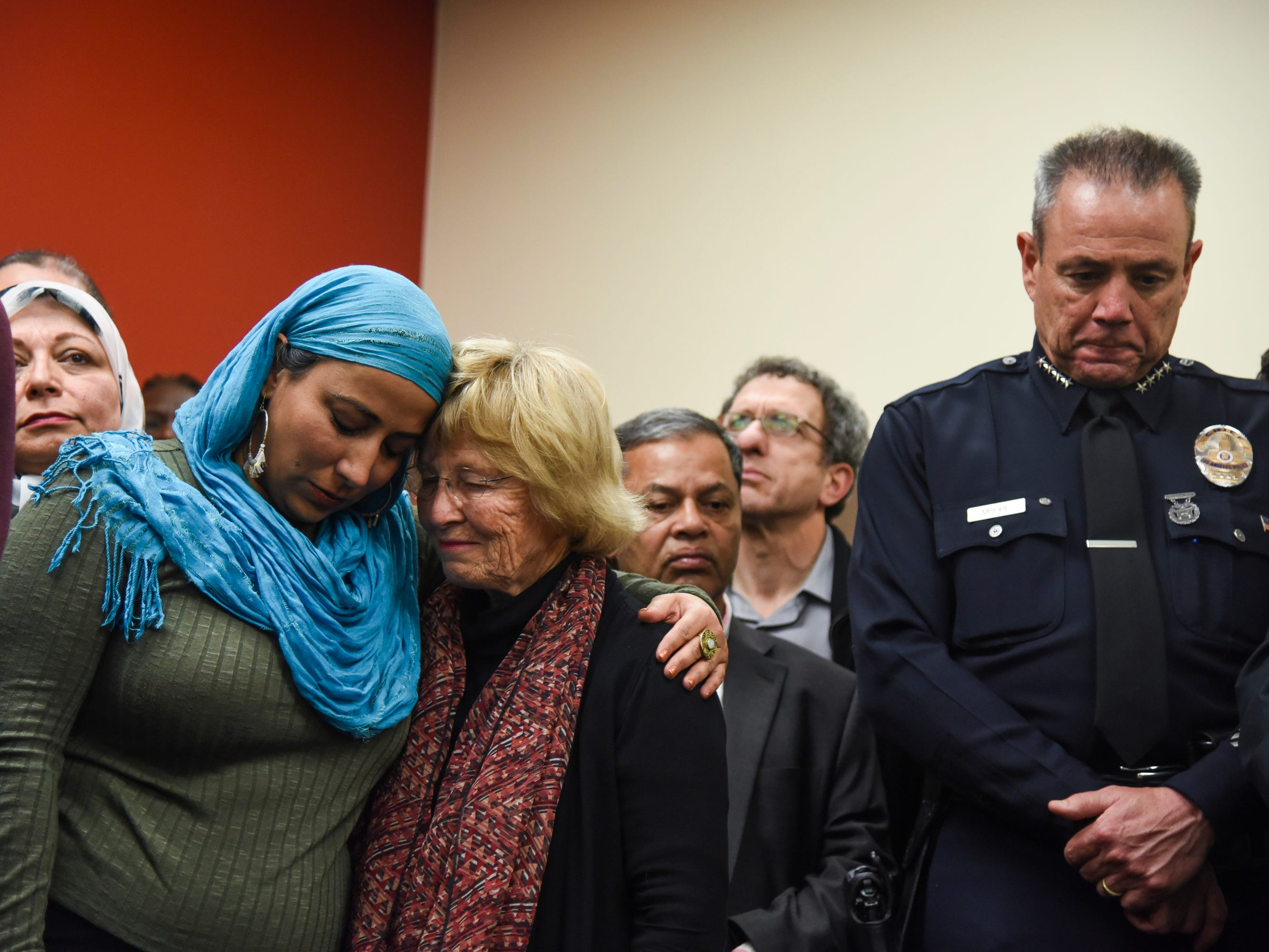 Various community leaders and officers comfort each other during a press conference at the Southern California Islamic Center in Los Angeles, Calif. on March 15, 2019. The press conference was organized after a man opened fire at two Mosques in New Zealand, killing 49 and wounding many more.