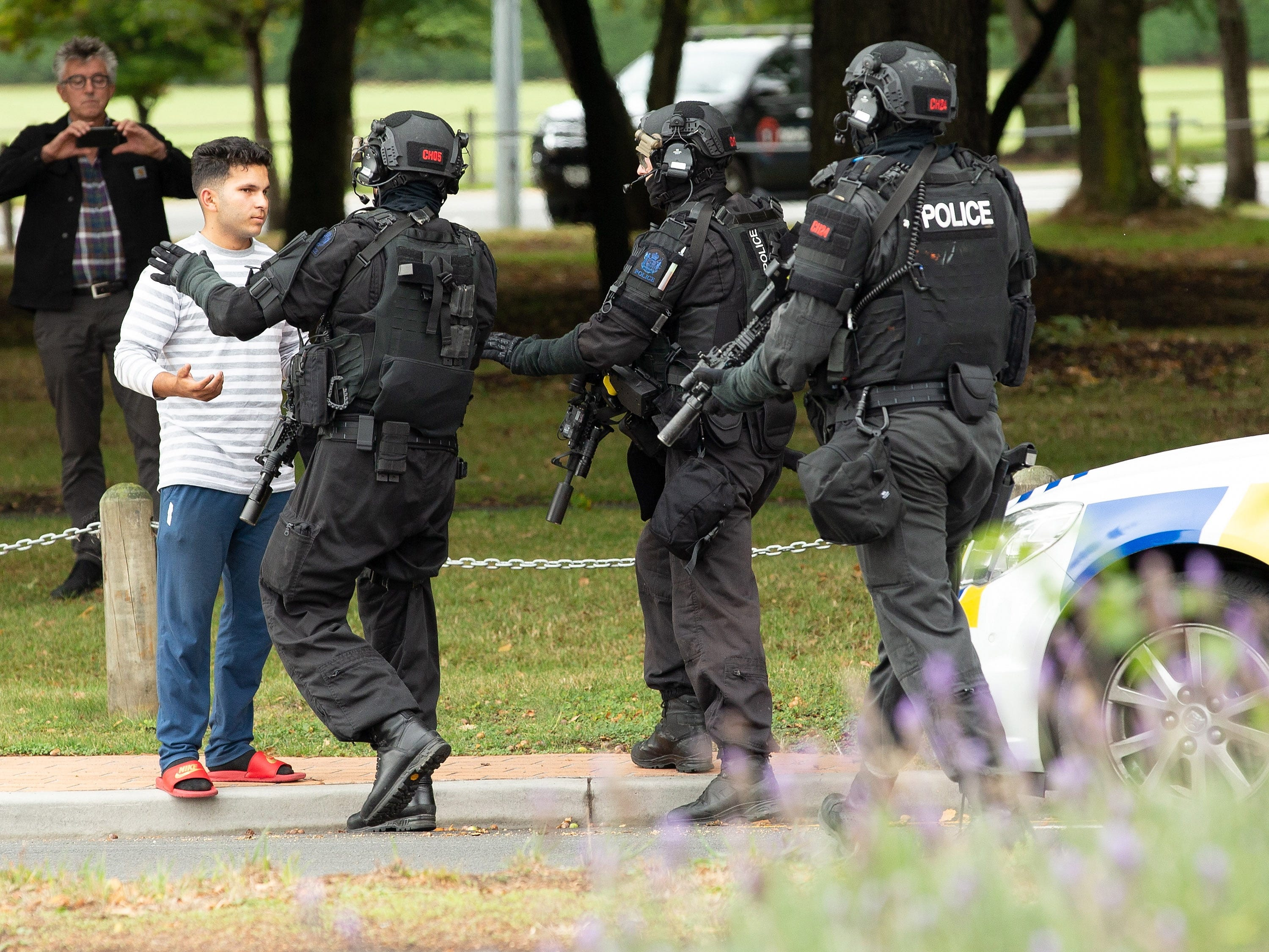 AOS (Armed Offenders Squad) officers push back members of the public following a shooting resulting in multiple fatalies and injuries at the Masjid Al Noor on Deans Avenue in Christchurch, New Zealand, 15 March 2019.