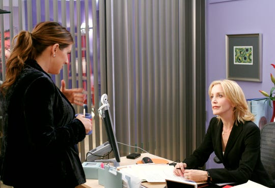 Joely Fisher and Felicity Huffman in a scene from