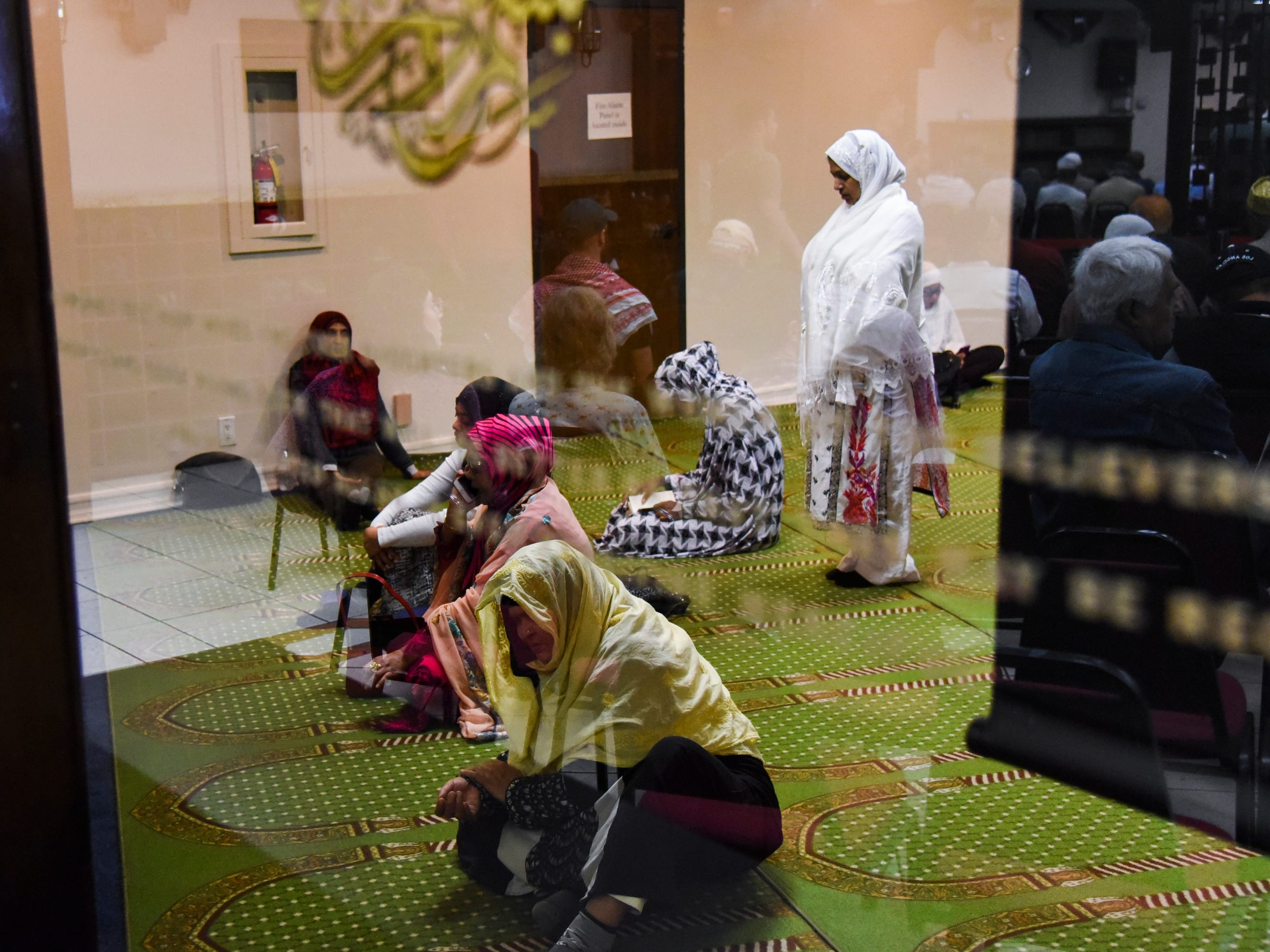 Women pray and prepare for the weekly Jum'a prayer service at the Southern California Islamic Center in Los Angeles, Calif. on March 15, 2019. Yesterday, a man opened fire at two Mosques in New Zealand, killing 49 and wounding many more.